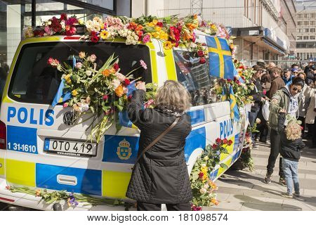 STOCKHOLM, SWEDEN - April 09, 2017: Flowers on a police van. truck attack in central Stockholm, Sweden