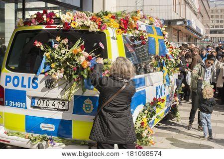 STOCKHOLM, SWEDEN - April 09, 2017: Flowers on a police van. truck attack in central Stockholm, Sweden