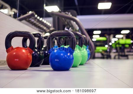 Sports kettlebell  weights on  floor in the gym.