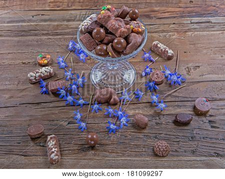 Falling chocolate on a cake stand with flowers