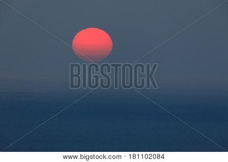 Sun at sunset and sea, Aegean Sea,Greece