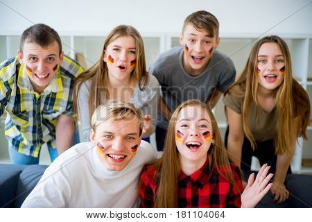 Group of german fans watching sports on TV