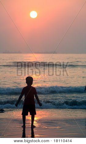 A boy and a sea surf