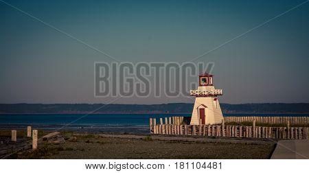 lighthouse at a wharf in nova Scotia
