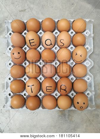 Dozen of chicken egg for cooking breakfast in the egg storage tray with blur background Easter egg for hiding Easter text and happy smiling surprise face