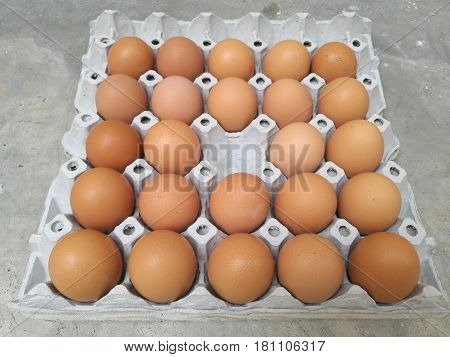 Dozen of chicken egg for cooking breakfast in the egg storage tray with egg center missing with blur background Easter egg for hiding Top view