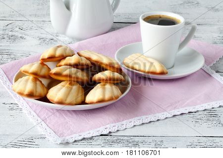 Madeleine cookies on a pink napkin and plate