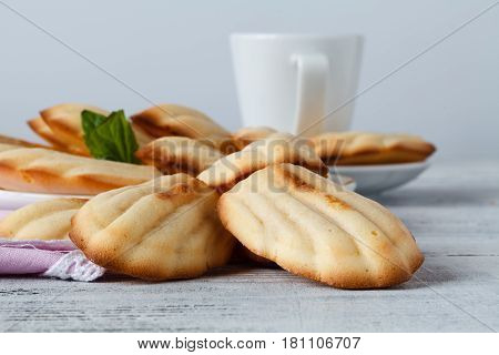 Sugar Powdered Madeleines With Coffee And Lemon. Selective Focus.