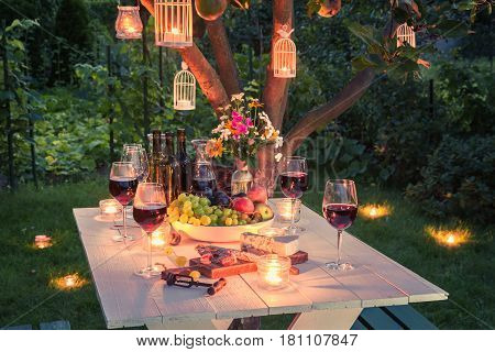 Beautiful Table Full Of Wine, Cheese And Snacks At Dusk