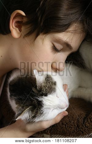 Teen Boy With Cat Close Up Portrait
