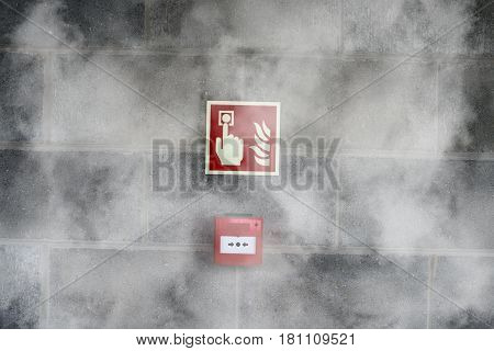 Emergency Fire Exit On The Stone Wall With Fire  Smoke