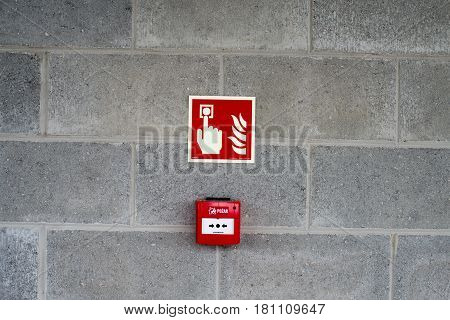 Emergency Fire Exit On The Stone Wall