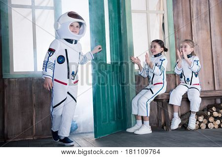 Children In Astronaut Costumes, Girls Applauding To Boy