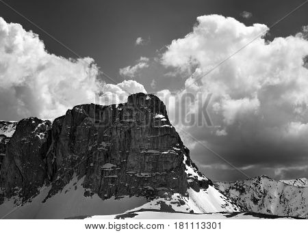 Black And White View On Snowy Rocks And Sky With Clouds In Nice Spring Day
