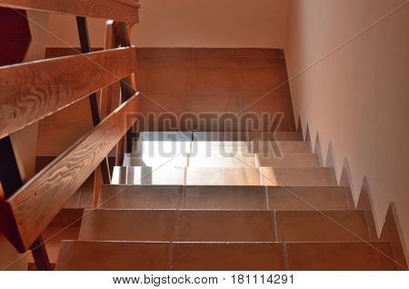 Staircase under sunlight in a hallway of a house