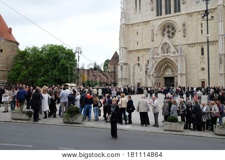 ZAGREB, CROATIA - APRIL 14: The faithful waiting in line in front of the cathedral to see the body of St. Leopold Mandic, Zagreb, Croatia on April 14, 2016.