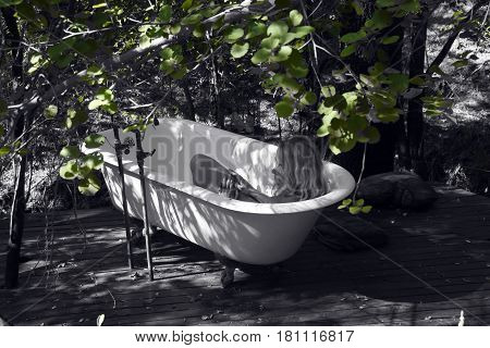 Picture of a woman taking a bath outdoors.
