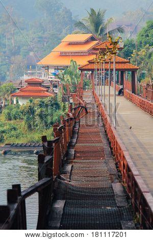 Old Rusty Thai Design Bridge in Sangkhlaburi District, Kanchanaburi, Thailand