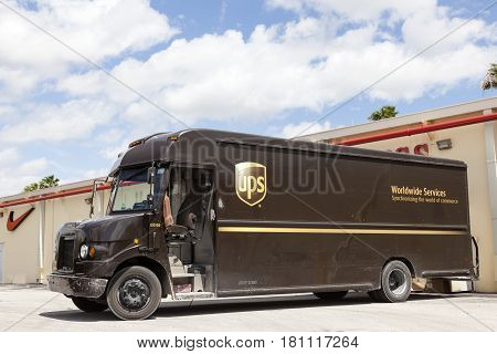 Homestead Fl USA - March 17 2016: United Parcel Service delivery truck delivering packages to the stores in a mall. Florida United States