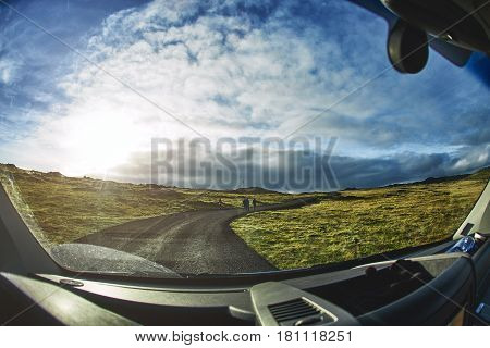 travel to Gunnuhver Hot Springs at Grindavik, Iceland. View from the driver place in car. The mud pools and steam vents on the southwest part of Reykjanes, Iceland.