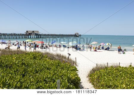 Naples Fl USA - March 18 2017: Beautiful white sand beach at the Gulf of Mexico coast in Naples. Florida United States