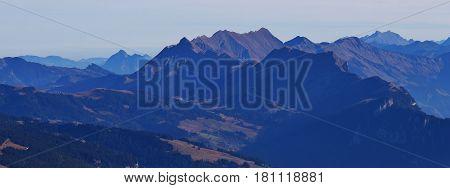 Mountains Augstmatthorn Brienzer Rothorn and Wilerhorn seen from mount Niesen. Autumn scene in the Bernese Oberland.
