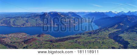 Autumn day in the Bernese Oberland. Villages Spiez Aeschi and Aeschiried. Lake Thunersee. Mount Niederhorn. View from mount Niesen.