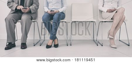 People waiting for recruitment interview. Job interview or meeting situation.