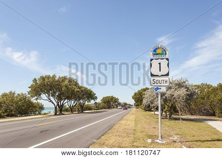 Key Largo Fl USA - March 16 2017: Florida scenic highway number one direction south on the Florida Keys United States