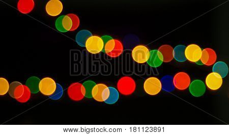 Brilliant circle bokeh lines made by blurry colorful lights