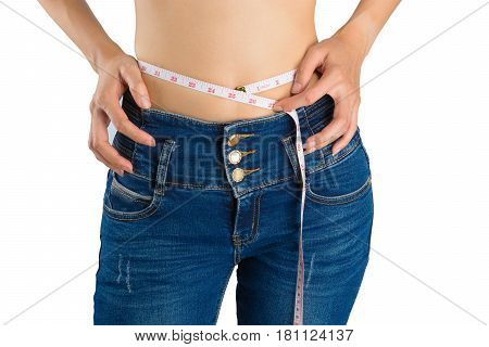 Girl On White In Blue Jeans And Tape Measure.