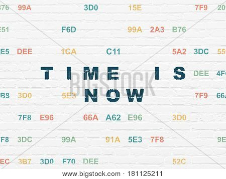 Time concept: Painted blue text Time is Now on White Brick wall background with Hexadecimal Code