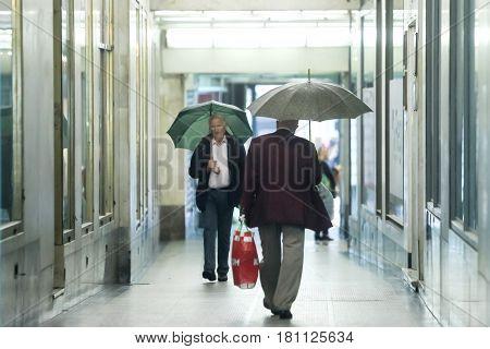 Senior Adults Walking In Passage
