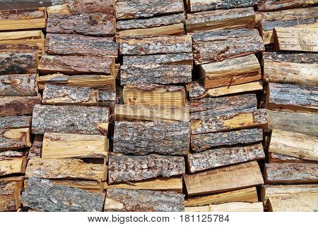 Stacked Pile of Split Firewood Ready for Winter