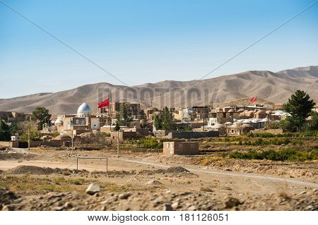 Rural scene of Iranian small town with mountain landscape near the highway from Tehran city to Isafan city Iran