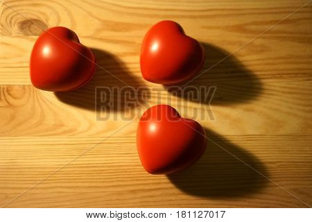 Three red heart and and their shadows