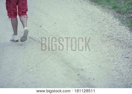 Man Walking Away on a village Road