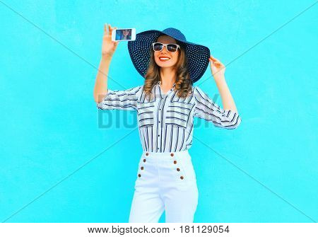 Fashion Young Smiling Woman Is Taking A Picture On A Smartphone Wearing A Straw Summer Hat, White Pa