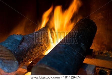 Fire And Wood Burning In A Fireplace. Close-up Image