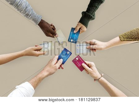 Group of hands holding credit card convenience life in aerial view