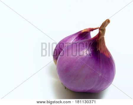 Fresh organic red shallot On a white background.