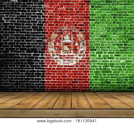 Afghanistan flag painted on brick wall with wooden floor