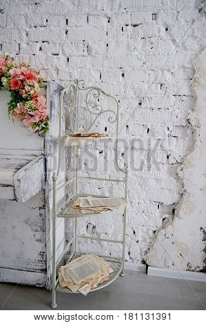Metal bookcase, with pages from books and Newspapers. Style romantic, sloppy.Color white