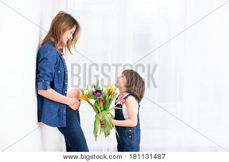 Pregnant Mother, Hugging Her Child, Receiving Tulips, Flowers For Holiday, Back Light