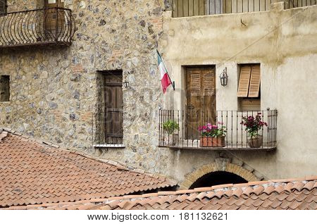 VAL'QUIRICO, TLAXCALA, MEXICO- MARCH 25, 2017: Facade of a building with balcony and a stone wall in Val'Quirico, a new town near to Tlaxcala, Mexico