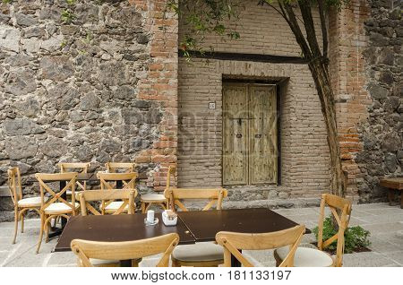VAL'QUIRICO, TLAXCALA, MEXICO- MARCH 25, 2017: Restaurant with stone wall in a street of Val'Quirico, a new town near to Tlaxcala, Mexico