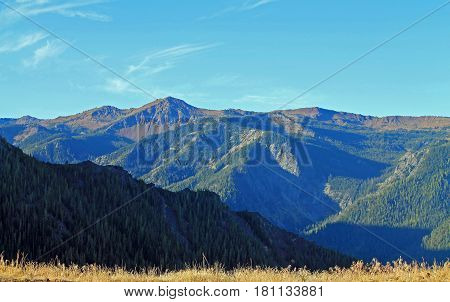Vista of Distant Forested Mountains at Sunrise in Eastern Oregon USA