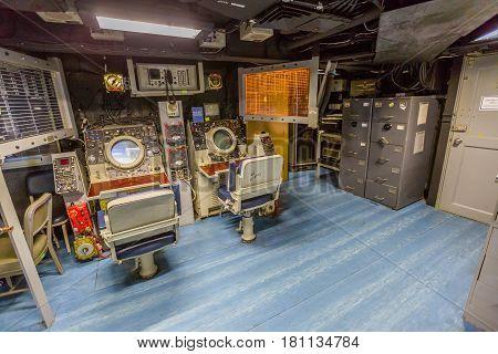 HONOLULU, OAHU, HAWAII, USA - AUGUST 21, 2016: operations room with lights on instruments, consoles, maps and radars of Battleship Missouri at Pearl Harbor, National Historic Landmark.