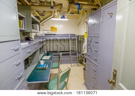 HONOLULU, OAHU, HAWAII, USA - AUGUST 21, 2016: double officers room with washbasin and desks in Battleship Missouri at Pearl Harbor. The end World War II was signed on this warship