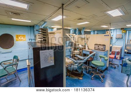HONOLULU, OAHU, HAWAII, USA - AUGUST 21, 2016: dentist room with operating tools and chair of Battleship Missouri at Pearl Harbor. The end World War II was signed on this warship.